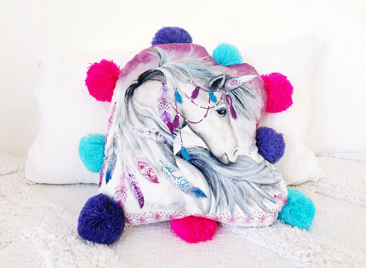 Lisa Pollock shaped unicorn cushion